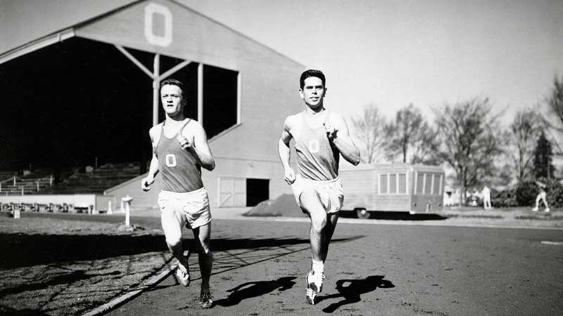 distance runners Bill Dellinger (left) and Jim Bailey running at Hayward Field during a 1955 practice