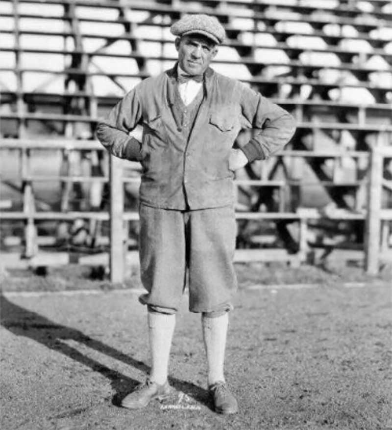 University of Oregon track coach Bill Hayward standing in front of the bleachers at Hayward Field in 1926.