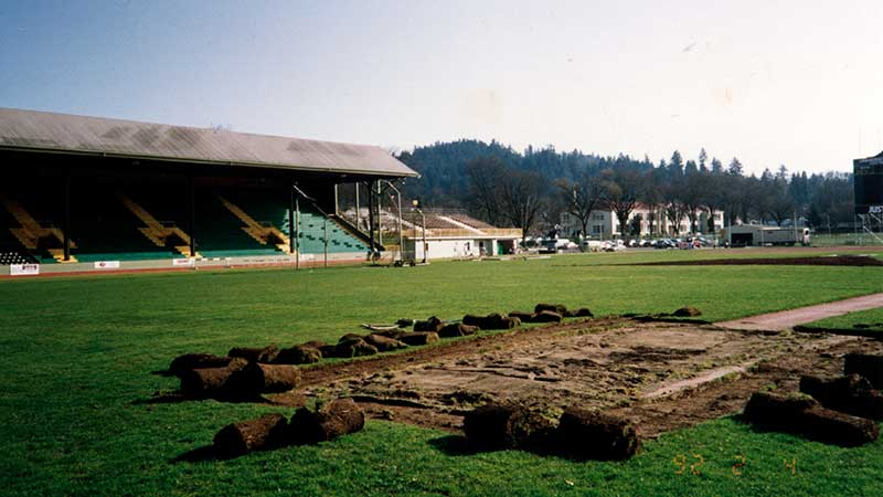 The northwest jumping pit surrounded by rolls of sod during a renovation at Hayward Field around 1970