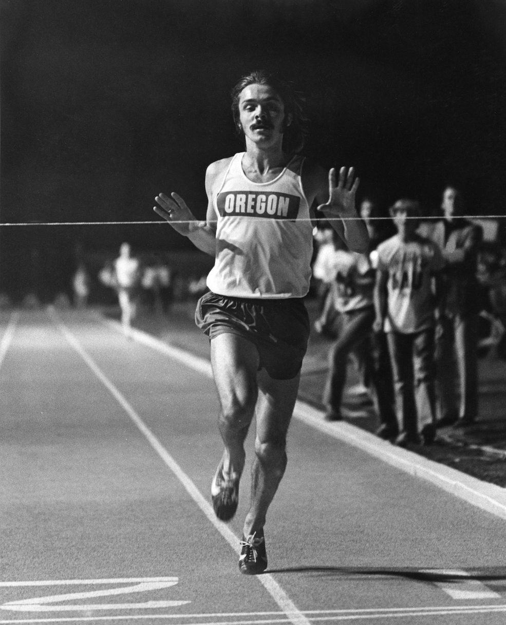 Prefontaine crossing a race finish line.