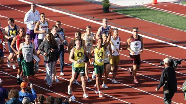 Ashton Eaton taking a victory lap with all of the decathletes at the NCAA Outdoor Track and Field Championships at Hayward Field