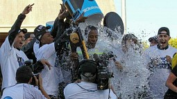 University of Oregon head track and field coach Robert Johnson being doused with water by the team after winning the 2015 team title at the NCAA track and field championships on June 12, 2015 at Hayward Field.
